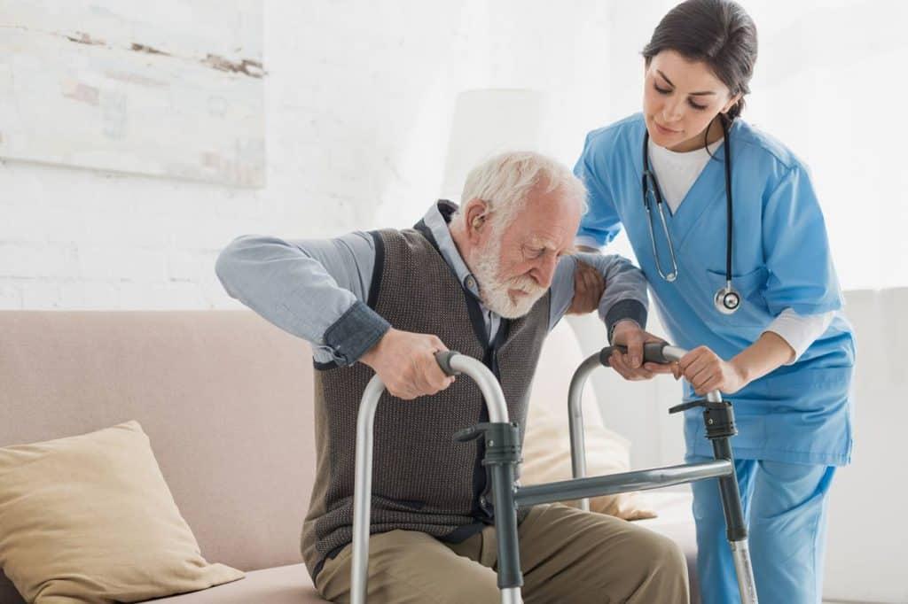 Nursing home rehabilitation man with walker